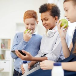 school-children-using-phone-at-school.jpg